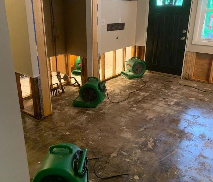 Entryway with SERVPRO drying equipment on subfloor