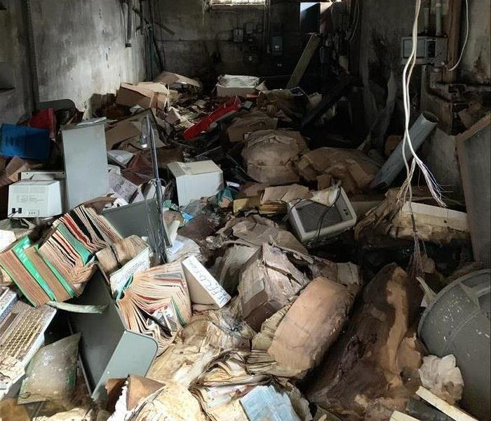 Cluttered basement with various objects piled up