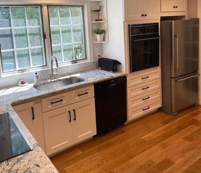Kitchen with granite countertops and laminate wood flooring