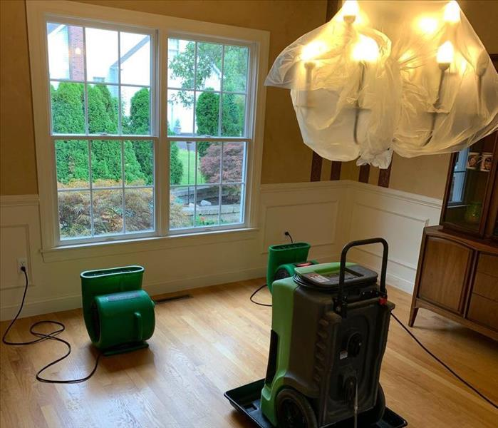 SERVPRO air movers and dehumidifier drying a dining room ceiling