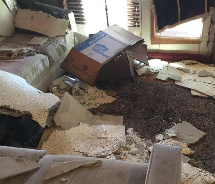 fallen ceiling tiles clutter room carton and more damage